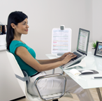Woman Working in I-Spire Home Office Workspace